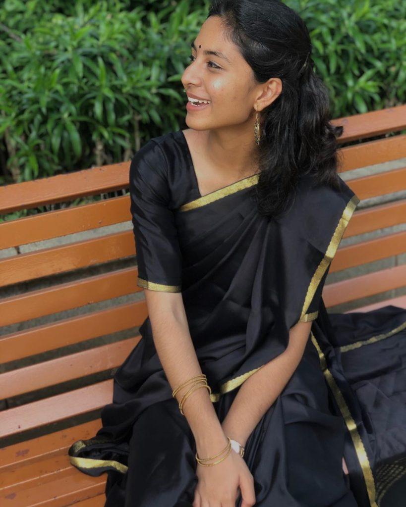 Hazel In Black Saree