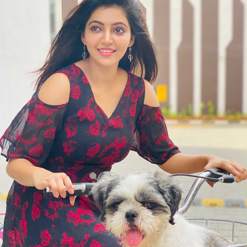 Athulya with her pet